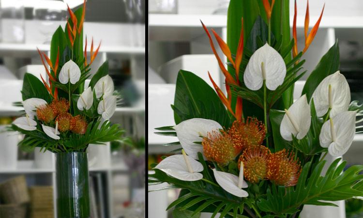 white and orange floral reception arrangement