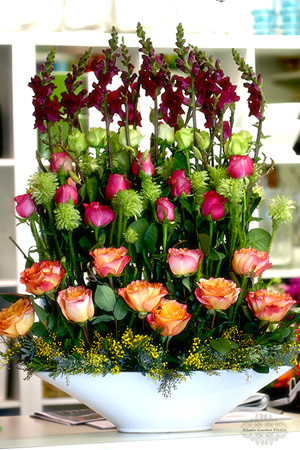 large tiered arrangement with roses