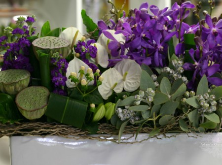 purple white green flower arrangement delivered gold coast