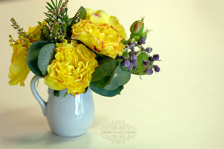 spray rose miniature arrangement in a jug
