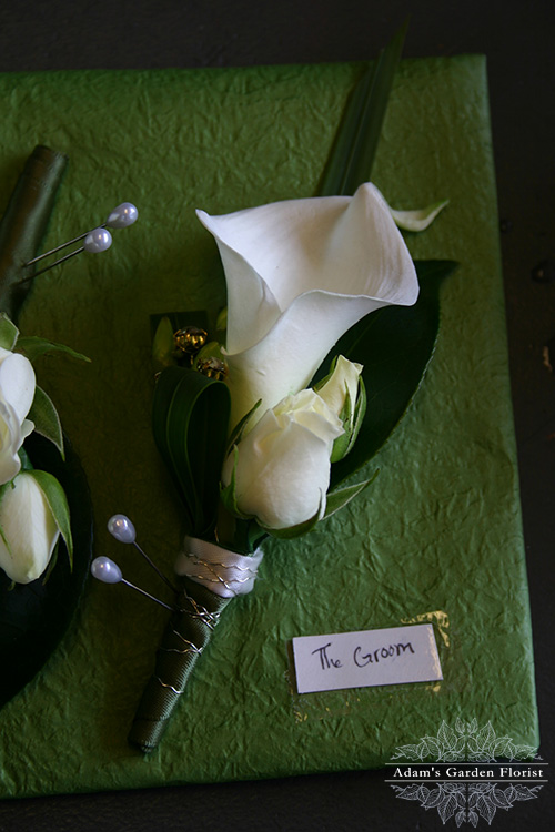 calla buttonhole for the groom