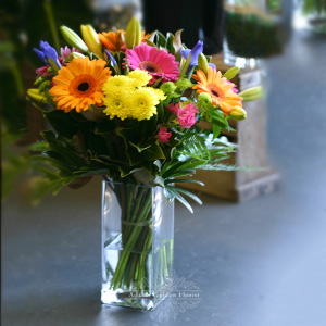 colourful bouquet in vase small to medium