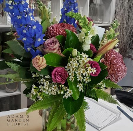 bouquet in a vase, warm pinks and blues. Gold Coast delivery