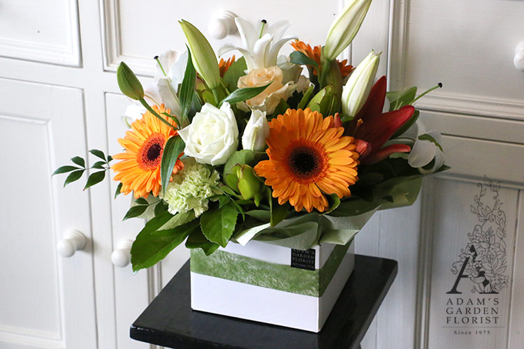 floral box arrangement white orange green gold coast florist