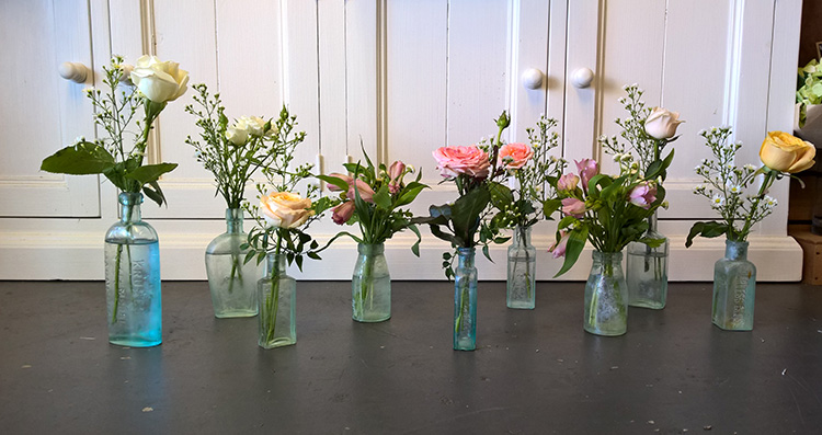 florist cottage flowers in vintage bottles gold coast