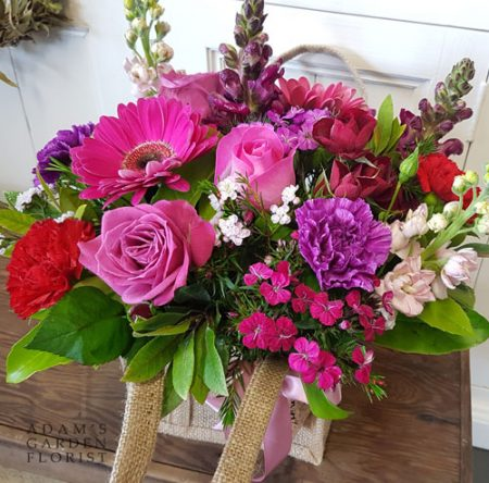 Florals in hessian bag, warm pink tones. Gold Coast delivery