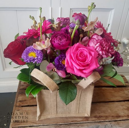 Floral arrangement in hessian bag. Small, pinks. Gold Coast delivery.