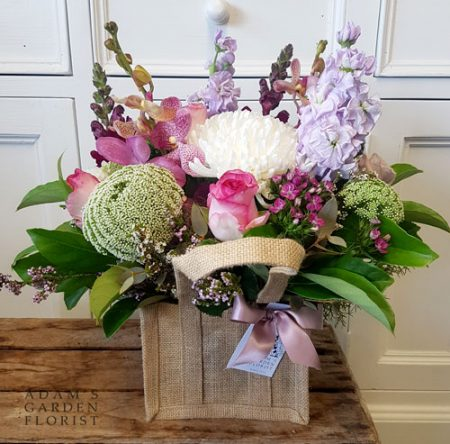 Floral arrangement in hessian bag. Small, pink+pretty. Gold Coast delivery.
