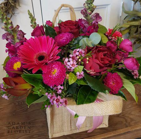 Floral arrangement in jute bag. Medium, pink+red. Gold Coast delivery.