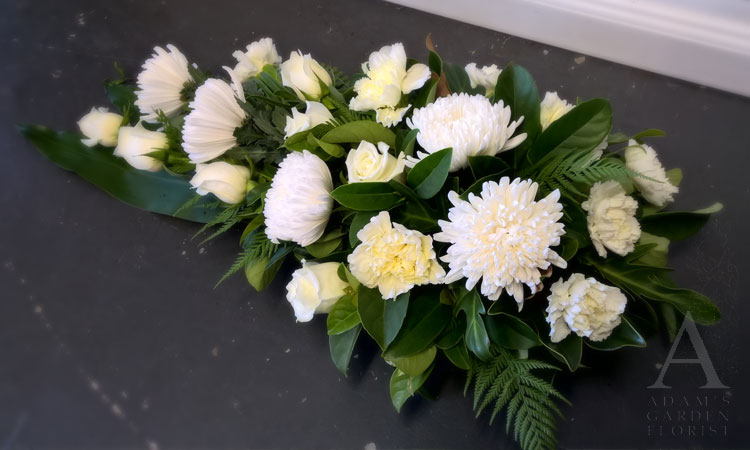 white funeral flower spray gold coast parkwood florist