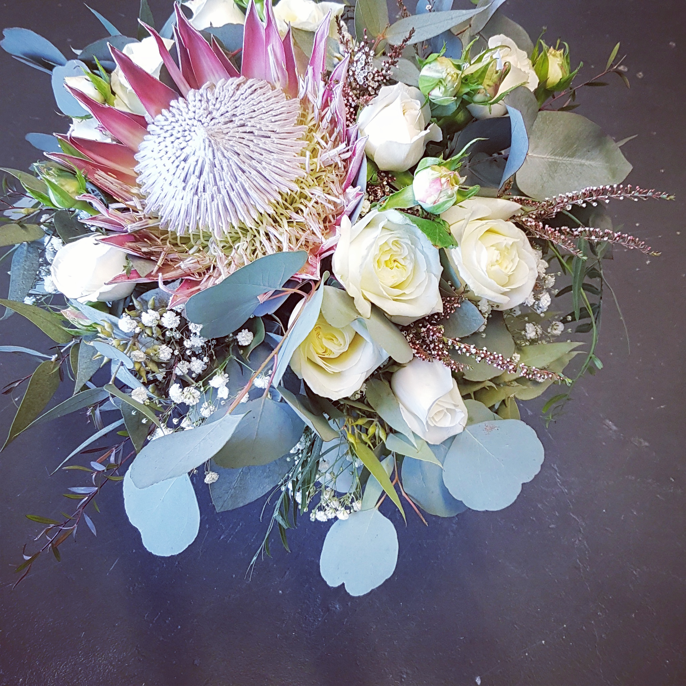 king protea with cottage roses and polyanthemos